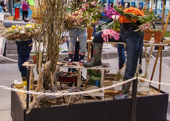 small display at Canada Blooms - hard to describe - jeans, stiffed wth something, made to look like the bottom half of people, but with flowers growing above the beltline instead of a ...waist and torso.