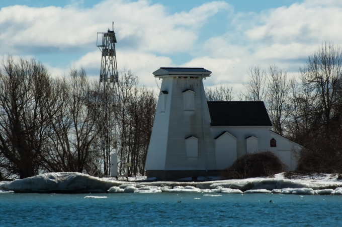 Closeup of the lighthouse - old structure on the right, metal one on the left.
